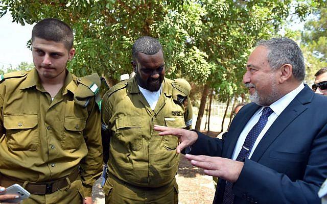 Defense Minister Avigdor Liberman during a visit to the IDF's Havat Hashomer base, August 23, 2016. (
