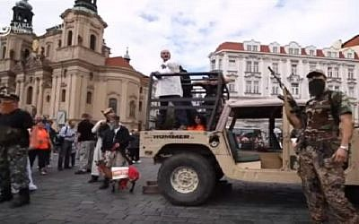 Anti-Islamic activists simulate a terror attack by the Islamic State jihadist group in downtown Prague, Czech Republic on August 21, 2016. (screen capture: YouTube)