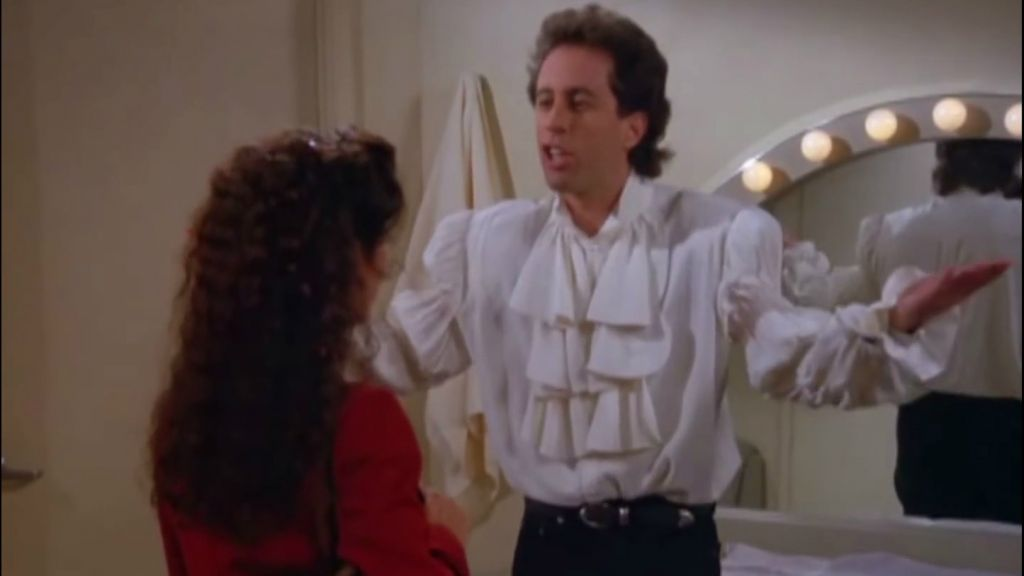 Jerry Seinfeld wearing the shirt that inspired a viral comparison to Melania Trump 20 years later. (Screenshot: Youtube)