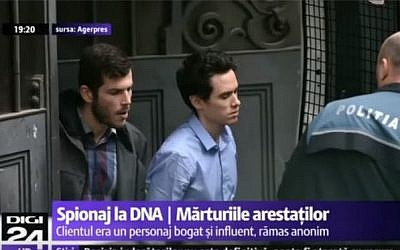 David Geclowitz and Ron Weiner, employees of the Israeli private intelligence firm Black Cube, being brought to the appeals court in Bucharest, after their arrest on suspicion of spying on the country's chief anti-corruption persecutor, April 12, 2016. (screen capture: YouTube)