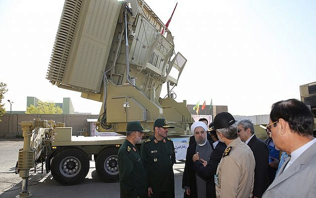 A handout picture provided by the office of Iranian President Hassan Rouhani on August 21, 2016 shows him (3rd-R) and Iranian Defence Minister Hossein Dehghan (2nd-L) standing next to the new Bavar 373 missile defence system in Tehran. The system was designed to intercept cruise missiles, drones, combat aircraft and ballistic missiles, according to earlier statements by Dehghan. (AFP PHOTO / IRANIAN PRESIDENCY)