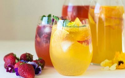 White Peach Sangria with Orange Blossom Water and Strawberry Rosé Sangria (Samantha Ferraro/ via JTA)