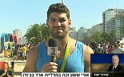 Israeli judoka Or Sasson speaks to Prime Minister Benjamin Netanyahu a day after winning the bronze medal at the Olympic Games in Rio. (Screenshot/Channel 2)