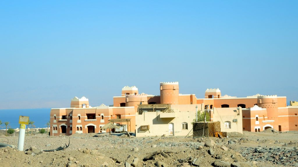 The tourism bust in the Sinai peninsula has left many half-built hotels dotting the beach directly south of Taba, including this abandoned project, seen on August 11, 2016. The kilometers of abandoned hotels and empty roads next to Taba make it seem like the area has survived some kind of apocalypse. (Melanie Lidman/Times of Israel)