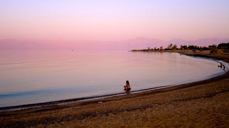 The quiet of Sinai descends immediately upon arrival, and the terrorism threats seem to belong to another world. Israeli tourists watch the sunset on August 12, 2016. (Melanie Lidman/Times of Israel)