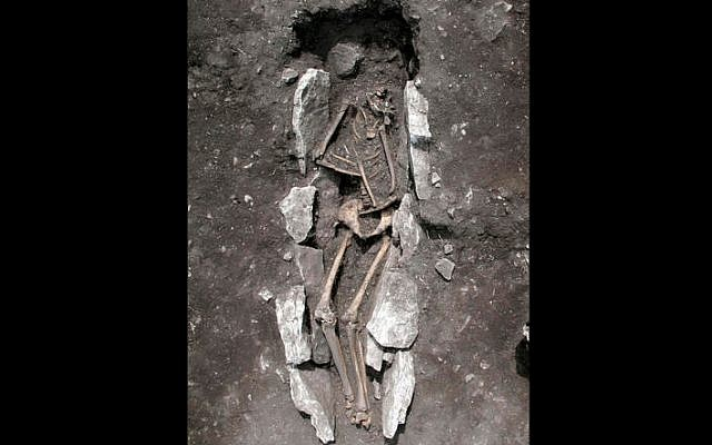 This undated photo released Aug. 10, 2016, provided by the Greek Culture Ministry, shows the 11th century BCE skeleton of a teenager excavated recently at Mount Lykaion in the southern Peloponnese region of Greece, the mountaintop sanctuary of Zeus, king of the ancient Greek gods. (Greek Culture Ministry via AP)