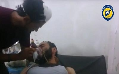 A man being treated at hospital after a suspected chemical weapons attack in Idlib province in Syria, August 1, 2016. (Screenshot/YouTube)
