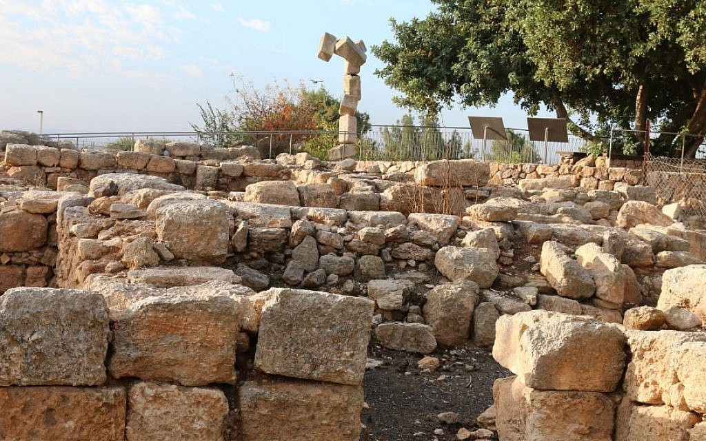 "A ""toppling rock"" sculpture behind archaeological excavations at Ramat Rachel. (Shmuel Bar-Am)"