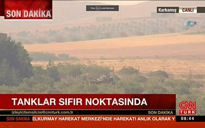 Turkish tanks mass on the border with Syria on August 24, 2016, as Ankara gears up for a ground operation against the Islamic State. (screen capture: CNN Turk)
