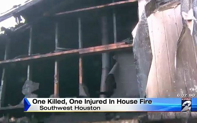 The burned-out home of Eva Lou and Julius Chapman in Houston, August 19, 2016. (Screen capture, KPRC 2 television news)