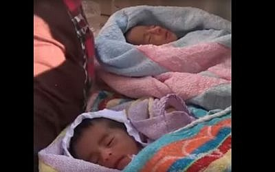 Five-day-old twins were among 6,500 people rescued from the Mediterranean Sea off the Libyan coast on August 30, 2016 (screen capture: YouTube)