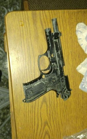 A pistol uncovered by IDF troops during a night-time raid near Hebron on August 17, 2016. (IDF Spokesperson's Unit)