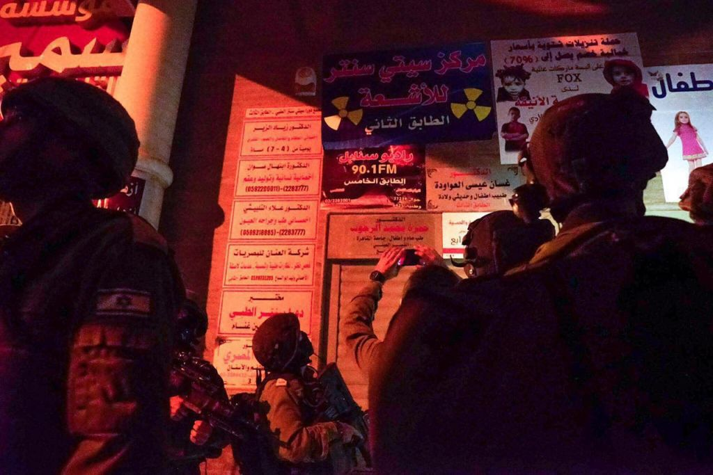 IDF soldiers stand outside the al-Sabanel radio station in Dura before closing the broadcaster because of 'inciting programs' on August 31, 2016. (IDF Spokesperson's Unit)