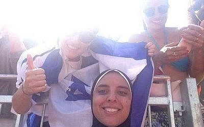 Olympic beach volleyball contender Doaa Elghobashy smiles for a photo as a woman wearing an Israel flag poses behind, August 2016, Courtesy Facebook