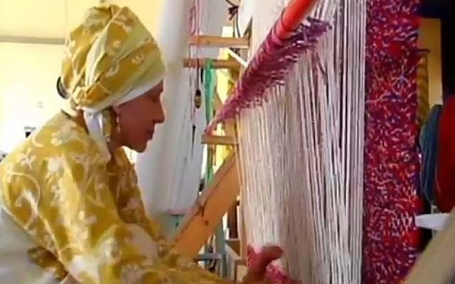A woman weaves a parochet in preparation for the Third Temple in the West Bank settlement of Itamar (Channel 2 News)
