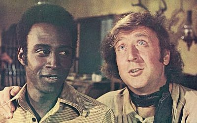 "Gene Wilder, right, in a scene with Cleavon Little from the 1974 comedy ""Blazing Saddles."" (JTA/Warner Bros./Courtesy of Getty Images)"