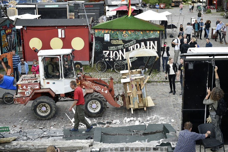 Residents clean the area in the Freetown Christiania neighborhood of Copenhagen, on September 2, 2016. (Scanpix Denmark /Uffe Weng /AFP)