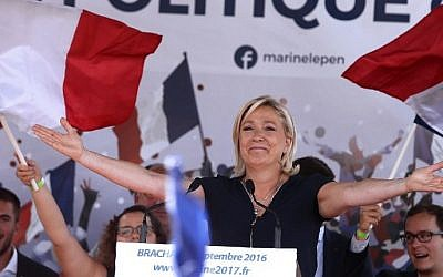 French far-right party Front National (FN) President and member of the European Parliament, Marine Le Pen gestures as she delivers a speech on September 3, 2016 during a FN political rally in Brachay, northeastern France. (AFP PHOTO / FRANCOIS NASCIMBENI)