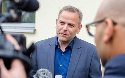 Top candidate of the populist right party Alternative for Germany (AfD), Leif-Erik Holm, talks to the media  during the regional elections in Barner Stueck, near Klein Trebbow, Mecklenburg-Western Pomerania, eastern Germany, on September 4, 2016. (AFP PHOTO / dpa / Daniel Bockwoldt)