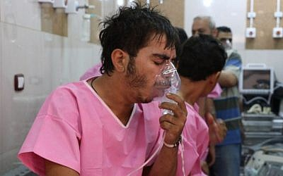 A Syrian man suffering from breathing difficulties is treated at a make-shift hospital in Aleppo on September 6, 2016. AFP/ THAER MOHAMMED)