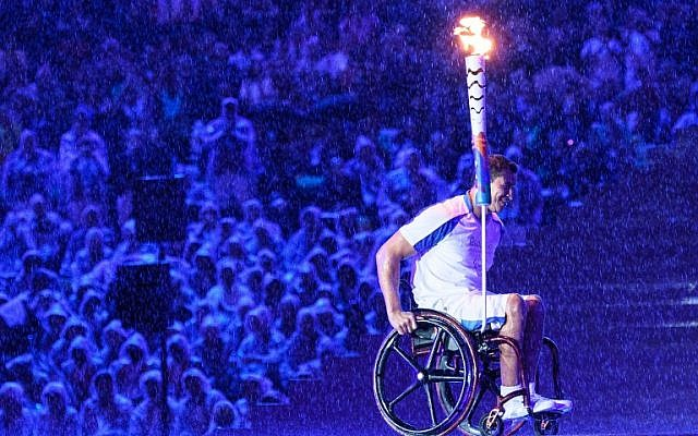 Brazilian swimmer Clodoaldo Silva holds the Paralympic torch to light the Paralympic cauldron during the opening ceremony of the Rio 2016 Paralympic Games at the Maracana stadium in Rio de Janeiro on September 7, 2016. (AFP PHOTO / YASUYOSHI CHIBA).