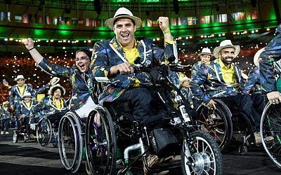 Members of Brazil's delegation enter during the opening ceremony of the Rio 2016 Paralympic Games at the Maracana stadium in Rio de Janeiro on September 7, 2016. (AFP PHOTO / YASUYOSHI CHIBA)