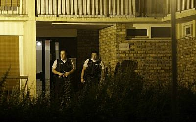 French police stand outside the building in Boussy-Saint-Antoine, south of Paris, on September 8, 2016 where female suspects said to have been planning new acts of jihadist violence were arrested. (Geoffroy van der Hasselt/AFP)