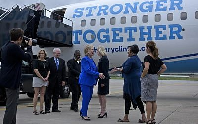 Democratic presidential nominee Hillary Clinton is greeted at Charles B. Wheeler Downtown Airport on September 8, 2016 in Kansas City, Missouri. (AFP PHOTO / Brendan Smialowski)
