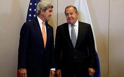 US Secretary of State John Kerry (L) and Russian Minister for Foreign Affairs Sergei Lavrov pose prior to a meeting to discuss the Syrian crisis on September 9, 2016, in Geneva. (AFP/Pool/Kevin Lamarque)