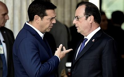 French President Francois Hollande (R) speaks with Greek Prime Minister Alexis Tsipras during the EU MED Mediterranean Economies Summit in Athens on September 9, 2016. (AFP PHOTO/ARIS MESSINIS)