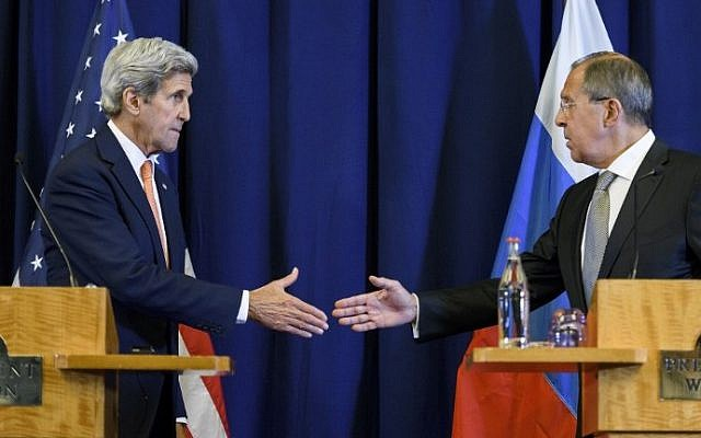 US Secretary of State John Kerry (L) and Russian Foreign Minister Sergei Lavrov shake hands at the end of a press conference closing meetings to discuss the Syrian crisis on September 9, 2016, in Geneva. (AFP PHOTO / FABRICE COFFRINI)