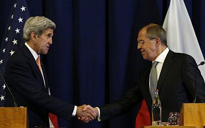 US Secretary of State John Kerry and Russian Foreign Minister Sergei Lavrov shake hands at a press conference in Geneva on September 9, 2016, where they announced a new plan for a ceasefire in the Syrian civil war and the foundation of a peace process. (AFP/Kevin Lamarque/Pool)