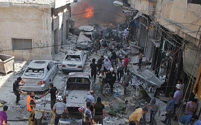 Syrians search for victims at the scene of a reported airstrike on the rebel-held northwestern city of Idlib on September 10, 2016. (AFP Photo/Omar Haj Kadour)