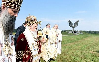 Ecumenical Patriarch Bartholomew I of Constantinople (2L), considered as the spiritual head of Constantinople Patriarchate's Orthodox Christians, is pictured near the Stone Flower monument for the victims of the Jasenovac concentration camp as he visits the site of the former camp in Jasenovac, Croatia on September 10, 2016. (AFP PHOTO / STR)