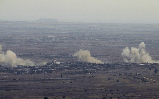 A picture taken from the Golan Heights on September 10, 2016, shows smoke rising from the Syrian village of Jubata al-Khashab. Israeli aircraft struck Syrian army positions after fire from its war-torn neighbor hit the Golan. (AFP/Jalaa Marey)