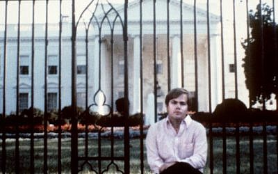 This file photo taken on March 01, 1981 shows  John Hinckley, who attempted to assassinate US President Ronald Reagan, in front of the White House in Washington, DC (AFP PHOTO)