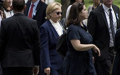 US Democratic presidential nominee Hillary Clinton arrives for a memorial service at the National 9/11 Memorial on September 11, 2016 in New York. The United States on Sunday commemorated the 15th anniversary of the 9/11 attacks. (AFP PHOTO / Brendan Smialowski)