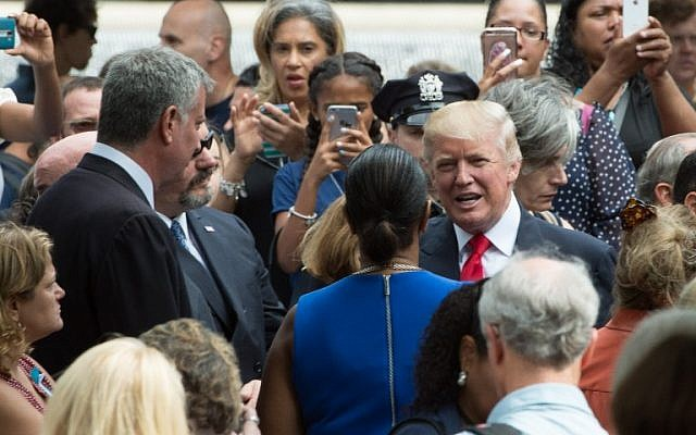 Republican presidential nominee Donald Trump during the 15th anniversary commemoration of the September 11 attacks at the 9/11 Memorial and Museum, Sunday, September 11, 2016 in New York. (AFP Photo/Bryan R. Smith)