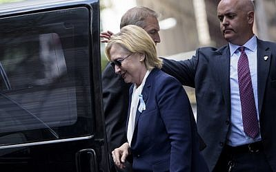 US Democratic presidential nominee Hillary Clinton gets in her car while leaving her daughter's apartment building after resting  on September 11, 2016, in New York. (AFP PHOTO/Brendan Smialowski)