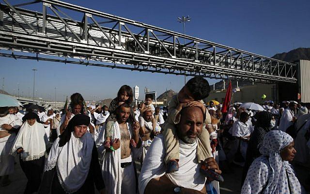 "Muslim pilgrims arrive to throw pebbles at pillars during the ""Jamarat"" ritual, the stoning of Satan, in Mina near the holy city of Mecca, on September 12, 2016.(AFP PHOTO / AHMAD GHARABLI)"