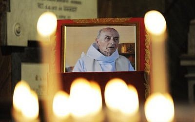 This file photo taken on August 17, 2016 shows a picture of slain Father Jacques Hamel displayed inside the church of San Luigi dei Francesi in downtown Rome. (AFP Photo/Marco Zeppetella)