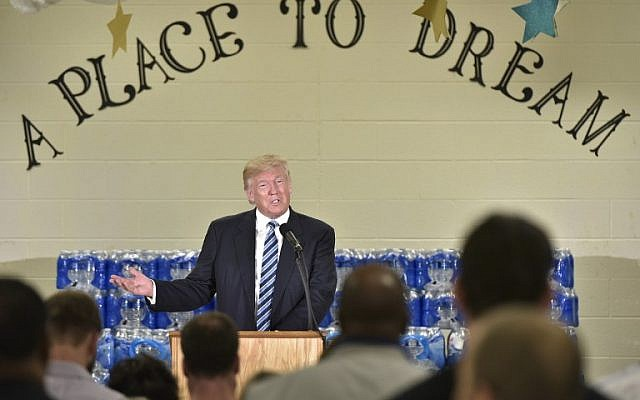 Republican presidential nominee Donald Trump speaks at the Bethel United Methodist Church on September 14, 2016 in Flint, Michigan. (AFP PHOTO / MANDEL NGAN)