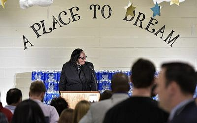 Rev Faith Green Timmons speaks before Republican presidential nominee Donald Trump at the Bethel United Methedoist Church on September 14, 2016 in Flint, Michigan. (AFP PHOTO / MANDEL NGAN)