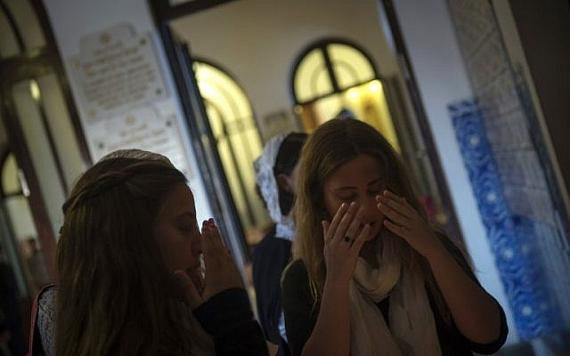 Members of the Jewish Community of Porto gesture as they arrive at the Kadoorie Mekor Haim Synagogue in Porto, on September 2, 2016 before the Shabbat celebrations. (AFP PHOTO / MIGUEL RIOPA)