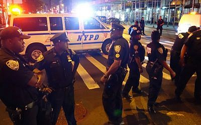 Illustrative: NYPD police officers block a road after an explosion in Manhattan on September 17, 2016. (William Edwards/AFP)