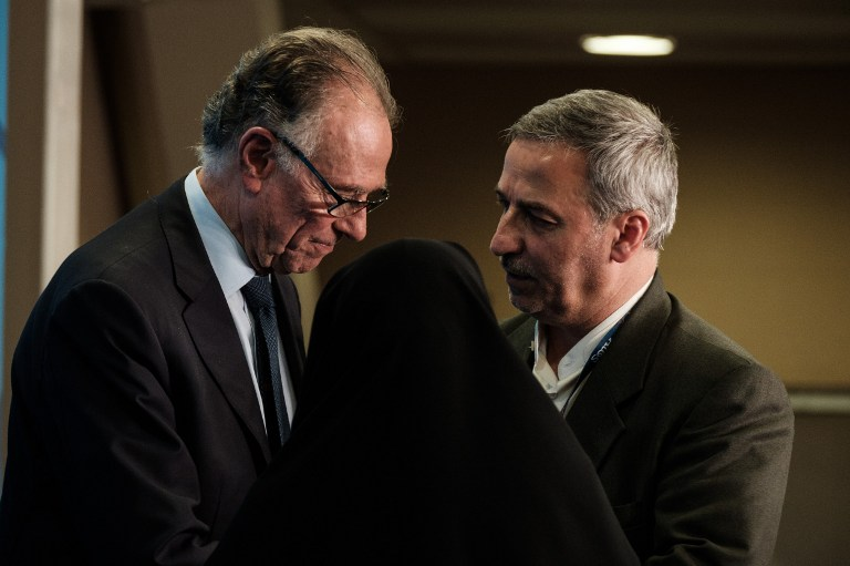 The President of the Rio 2016 Organizing Committee Carlos Nuzman (L) speaks with the secretary general of the Iran National Pralympic Committee Masoud Ashrafi after attending a press conference for the death of Iranian cyclist Bahman Golbarnezhad who crashed for death during men's road race (C4-5) of Rio 2016 Paralympic games at the Olympic park in Rio de Janeiro, Brazil, on September 17, 2016. / AFP PHOTO / Yasuyoshi Chiba