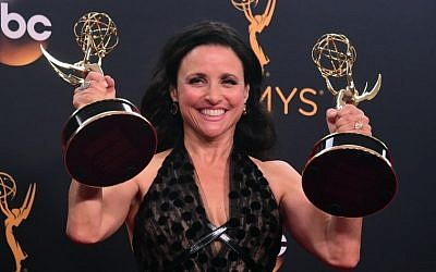 Actress Julia Louis-Dreyfus poses with the Emmy for  Outstanding Comedy Series and Outanding Lead Actress in a Comedy Series, in the press room during the 68th Emmy Awards on September 18, 2016 at the Microsoft Theater in Los Angeles.  AFP PHOTO/FREDERIC J BROWN)