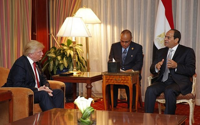 Then-Republican presidential candidate Donald Trump looks on as Egyptian President Abdel Fattah el-Sissi speaks during a meeting at the Plaza Hotel on September 19, 2016 in New York. (AFP/Dominick Reuter)