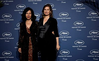 French actress Emmanuelle Devos (R) and writer Yasmina Reza pose as they arrive for a ceremony marking the 70th anniversary of the Cannes International Film Festival on September 20, 2016 in Paris. (AFP PHOTO / PHILIPPE LOPEZ)