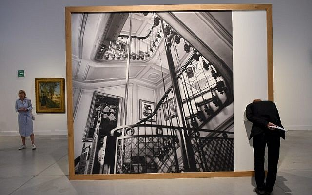 People attend the inauguration of '21 Rue de la Boetie,' an exhibition on legendary French art dealer Paul Rosenberg (1881-1959), at the Musee de la Boverie in Liege, Belgium on September 21, 2016. (AFP PHOTO/JOHN THYS)